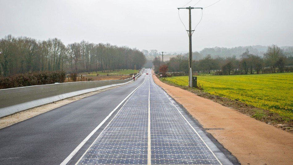 Solar panels well-layed on a road network in Normandy, France