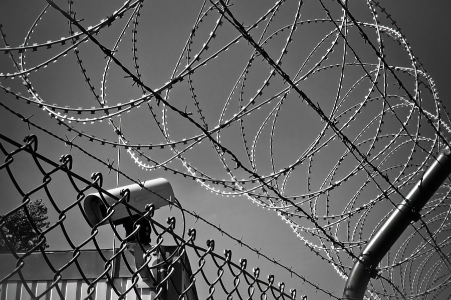 Barbed wire with a spy camera mounted for tracking what is going on around the environment