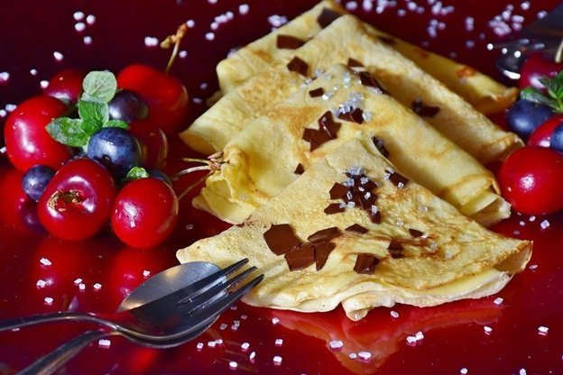 Styled and garnished sweet crepe with berries